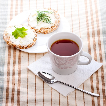 high key: diet breakfast with tea and corn bread Stock Photo