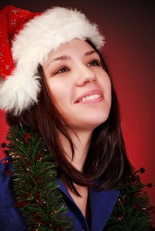 girl in santa hat portrait, red background Stock Photo - 8587011
