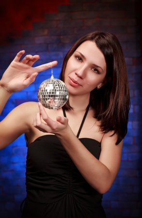 beautiful girl with decoration ball, blue background photo