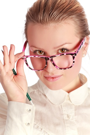 pretty teacher in funny eyeglasses with pen Stock Photo - 8630756