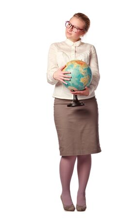 pretty teacher with globe dreaming about something Stock Photo - 8630730