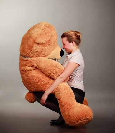 beautiful girl play with funny toy bear photo