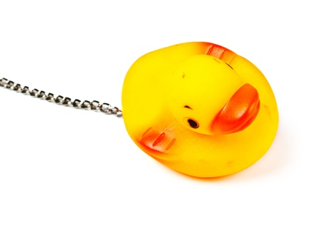 toy duck for bath with chain isolated on white Stock Photo - 8630712