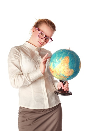 pretty teacher with globe dreaming about something photo