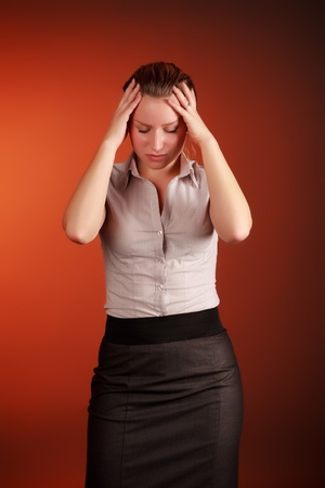 beautiful woman with headache on red background photo