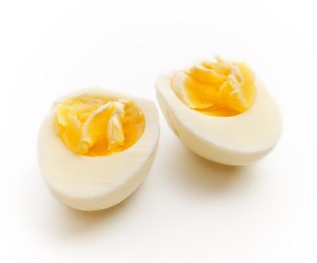 hard boiled egg sliced in half, gray background
