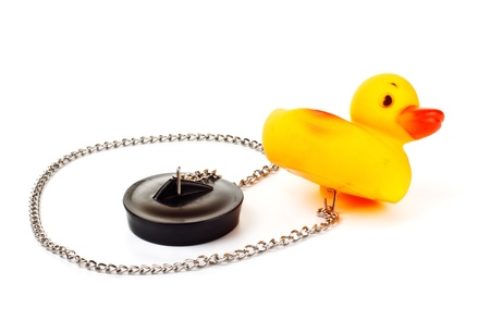 toy duck with plug for bath with chain isolated on white Stock Photo - 8698559