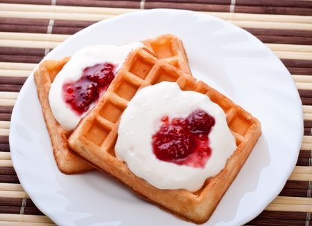 dessert with soft waffle and raspberry jam photo