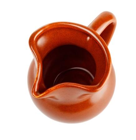 clay milk jug isolated on white background photo