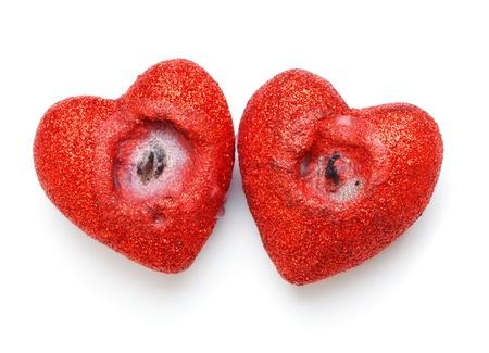 heart shaped candles isolated on white background photo
