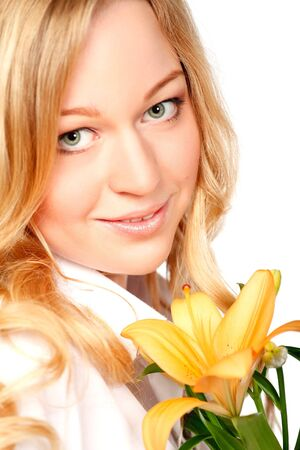 beautiful young woman with lily flower, close-up portrait Stock Photo - 8787090