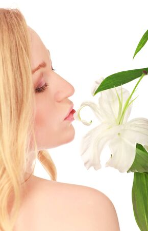 beautiful young woman kissing lily flower, close-up portrait Stock Photo - 8787117