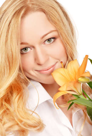 beautiful young woman with lily flower, close-up portrait photo