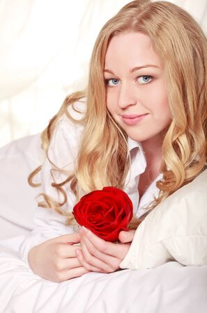 pretty girl in bed with red rose Stock Photo - 8787219