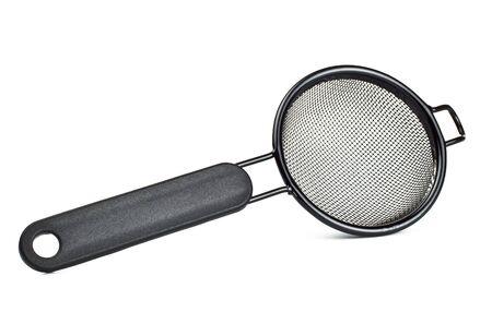 black tea strainer isolated on white background photo