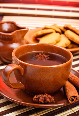 winter tea with cinnamon and star anise on bamboo napkin photo