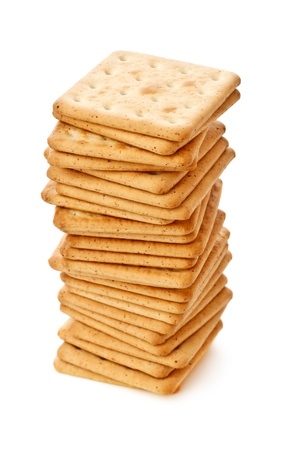 crackers: salty crackers pile isolated on white background Stock Photo
