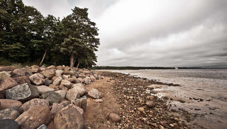 rocky stone beach at cold autumn day photo