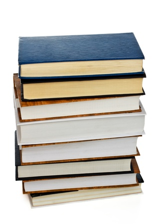 high stack of books isolated on white photo