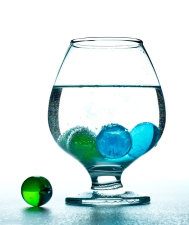 mineral water glass with decorative color stones photo