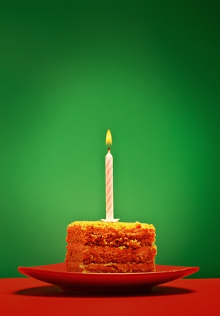 birthday cake with candle on pink background Stock Photo - 9040450