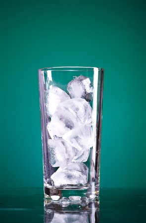 glass full of ice on green background Stock Photo - 9141024