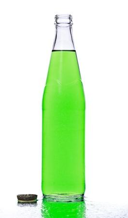 green soda bottle and ice cubes, white background photo