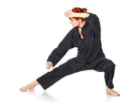 girl in black kimono exercise, isolated on white Stock Photo - 9183387