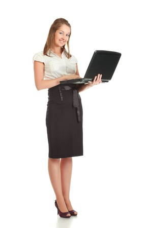 young businesswoman with laptop, isolated on white photo