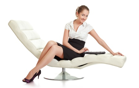 businesswoman skirt: young businesswoman sitting with laptop, isolated on white Stock Photo