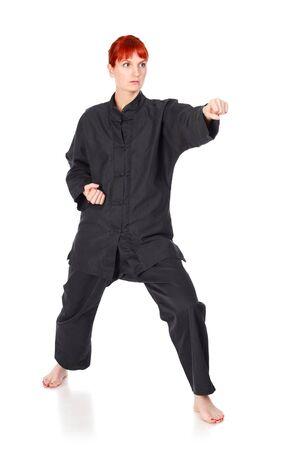 girl in black kimono exercise, isolated on white Stock Photo - 9245964