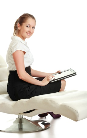 young businesswoman sitting with laptop, isolated on white photo