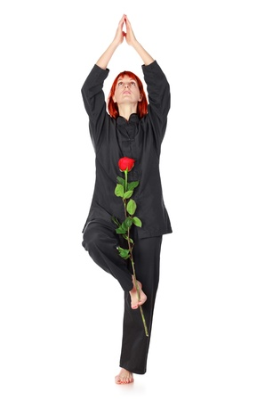girl in black kimono with red rose, isolated on white photo