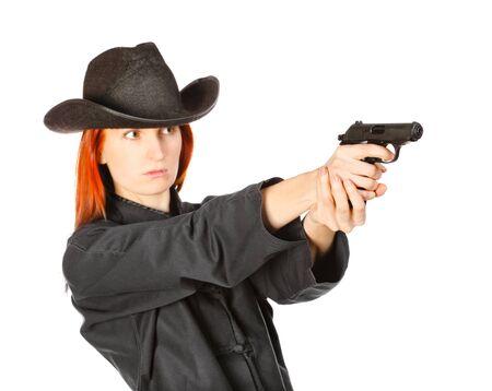 assasin: woman in black kimono aims with gun, isolated on white