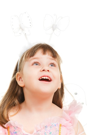 surprised little girl looking up, isolated on white Stock Photo - 9477776