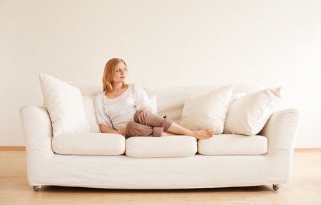 cute young girl relaxing on couch at home photo