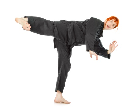girl in black kimono exercise, isolated on white photo