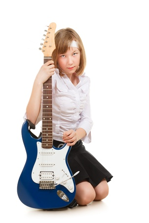 teen girl playing on a guitar, isolated on white Stock Photo - 9516379