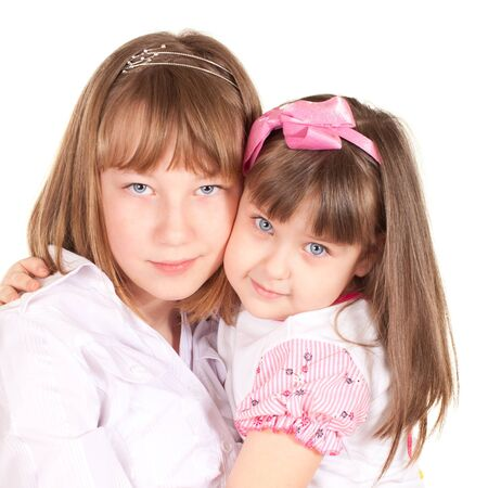 cute little sisters portrait, close up, isolated on white photo