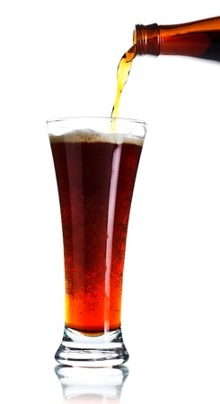 beer pouring from bottle into glass isolated photo