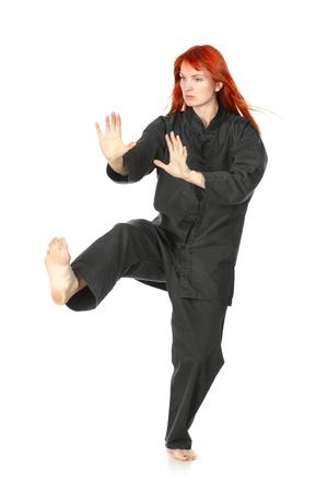 girl in black kimono exercise, isolated on white photo