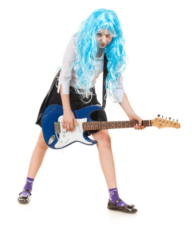 teen girl playing on a guitar, isolated on white Stock Photo - 9782955