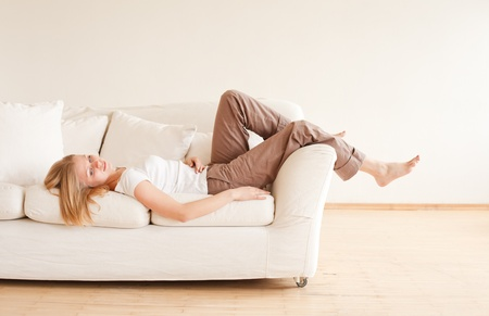 cute young girl relaxing on couch at home Stock Photo - 9783073