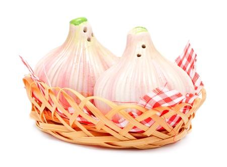 castors: garlic shaped pepper and salt castors isolated on white Stock Photo