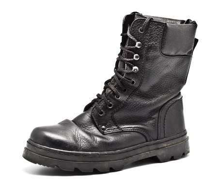 black leather army boot isolated on white photo