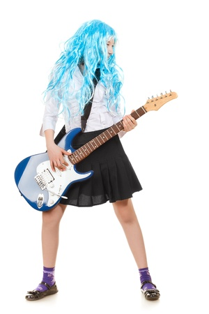 teen girl playing on a guitar, isolated on white Stock Photo - 9783097