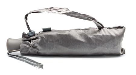 closed gray umbrella isolated on white background
