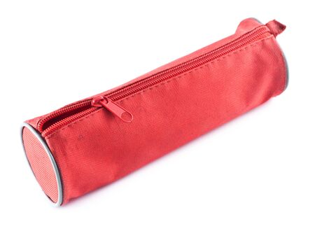 red fabric pencil-case isolated on white background photo