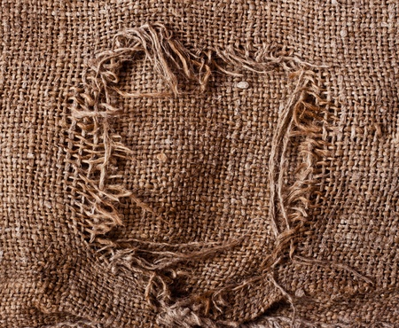 cloth fiber: old torn sacking grunge texture as background