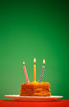 birthday cake with candle on pink background Archivio Fotografico